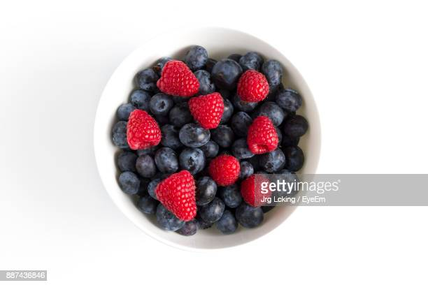 Berry Fruits In Bowl Against White Background