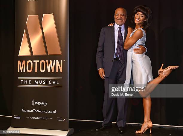 Berry Gordy and cast member Lucy St Louis attend the Motown The Musical photocall at The Hospital Club on October 5 2015 in London England