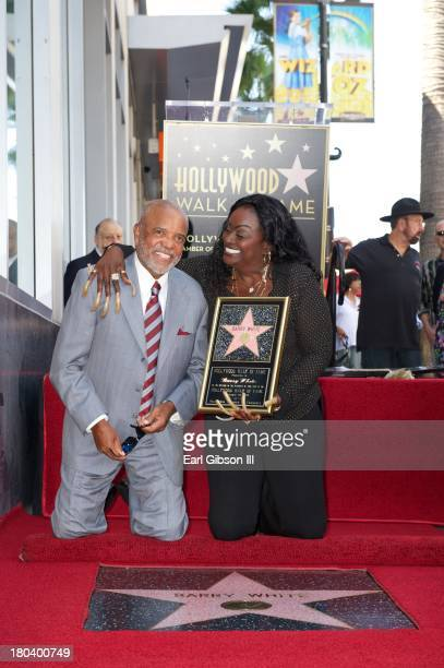 Berry Gordy and Glodean White pose for a photo as the late Barry White was honored posthumously with a star on the Hollywood Walk of Fame on...