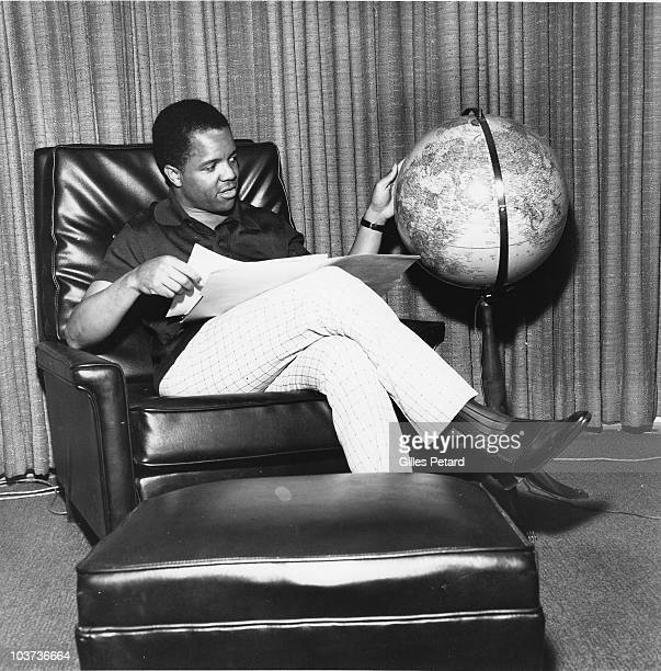Berry Gordy Jr of Motown Records poses in his office looking at a globe in 1966 in Detroit United States