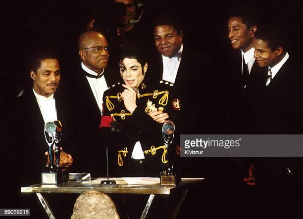 Berry Gordy Jr of Motown Records with Marlon Jackson Michael Jackson Tito Jackson Jermaine Jackson and Jackie Jackson of The Jackson 5 inductees