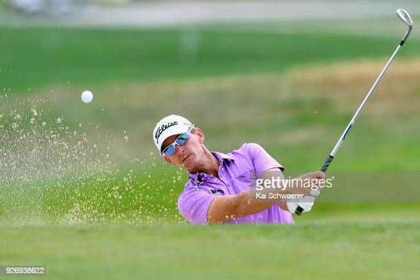 Berry Henson of the United States plays a bunker shot during day four of the ISPS Handa New Zealand Golf Open at Millbrook Golf Resort on March 4...