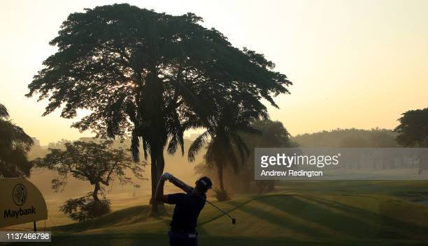 Berry Henson of the USA hits his teeshot on the tenth hole on Day Two of the Maybank Championship at at Saujana Golf Country Club Palm Course on...