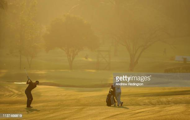 Berry Henson of the USA plays his second shot on the tenth hole on Day Two of the Maybank Championship at at Saujana Golf Country Club Palm Course on...