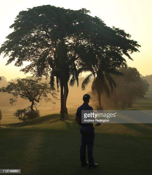 Berry Henson of the USA waits to hit his teeshot on the tenth hole on Day Two of the Maybank Championship at at Saujana Golf Country Club Palm Course...