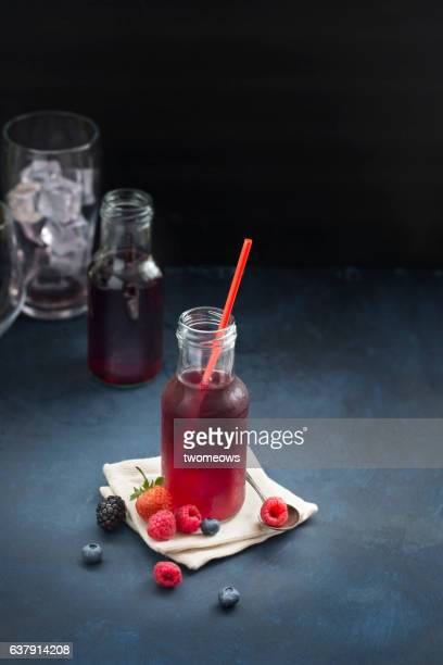 Berry juice on moody background.