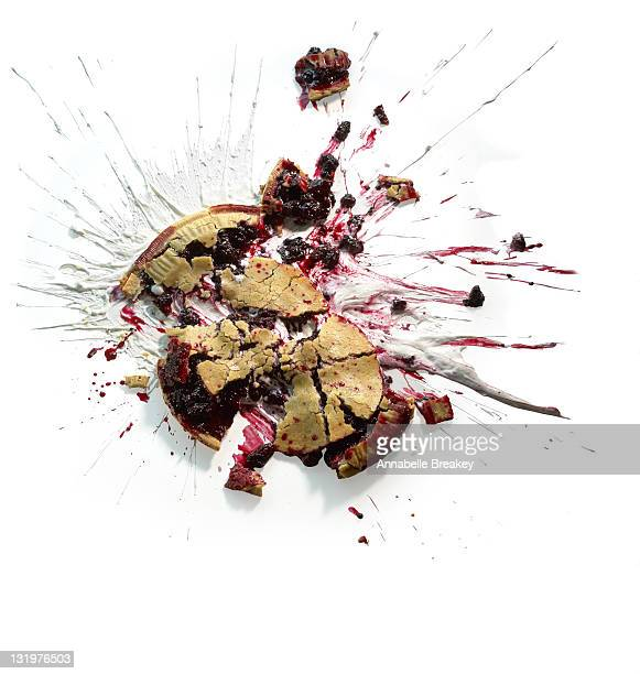 berry pie splat on white - messy stock photos and pictures