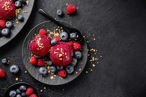 Berry refreshing ice cream scoops on plate 1153046270