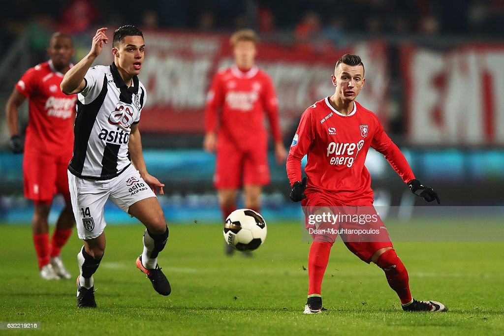 Bersant Celina of FC Twente passes the ball infront of Joey Pelupessy of Heracles Almelo during the Dutch Eredivisie match between FC Twente and Heracles Almelo held at De Grolsch Veste on January 20, 2017 in Enschede, Netherlands.