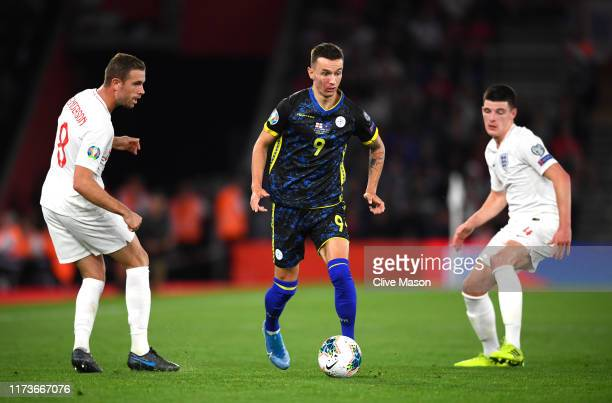 Bersant Celina of Kosovo is closed down by Jordan Henderson of England during the UEFA Euro 2020 qualifier match between England and Kosovo at St....