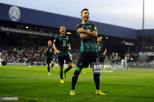 Bersant Celina of Swansea City celebrates after scoring the opening goal during the Sky Bet Championship match between Queens Park Rangers and...