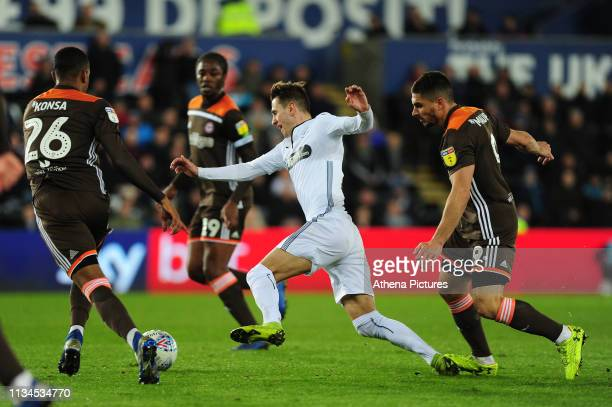 Bersant Celina of Swansea City is fouled by Neal Maupay of Brentford during the Sky Bet Championship match between Swansea City and Brentford at the...