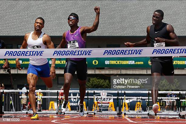 Bershawn Jackson celebrates as he crosses the finish line ahead of Johnny Dutch and Kerron Clement to win the the Men's 400 Meter Hurdles final...