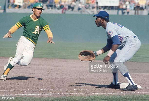 Bert Campaneris runs back to1st base guarderd by John Milner of the New York Mets during the World Series at Oakland-Alameda County Coliseum on...