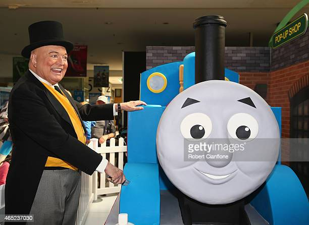 Bert Newton dressed as The Fat Controller cuts a Thomas the Tank birthday cake to celebrte the Thomas Friends 70th Birthday Celebration at Flinders...