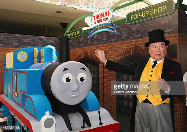 Bert Newton dressed as The Fat Controller is seen with a Thomas the Tank birthday cake to help celebrate the Thomas Friends 70th Birthday Celebration...
