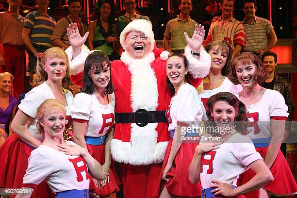 Bert Newton poses dressed as Santa Claus with cast members at the 'Grease' musical at The Regent Theatre on December 11 2014 in Melbourne Australia...