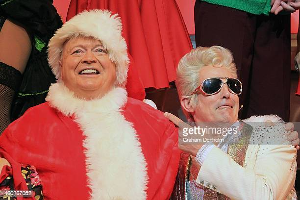 Bert Newton poses dressed as Santa Claus with Todd McKenney as Teen Angel at the 'Grease' musical at The Regent Theatre on December 11 2014 in...