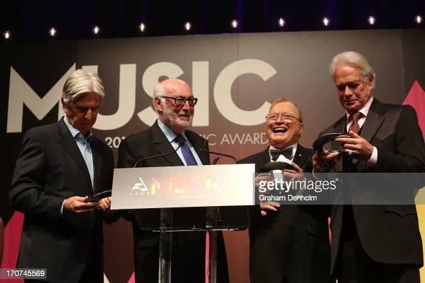 Bert Newton presents the Ted Albert Award for Outstanding Services to Australian Music to Keith Potger Athol Guy and Bruce Woodley from The Seekers...