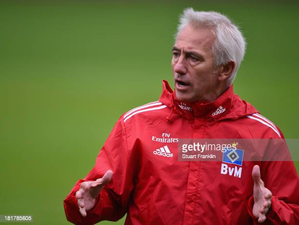 Bert van Marwijk gestures during his first training session as head coach of Hamburg SV on September 25 2013 in Hamburg Germany