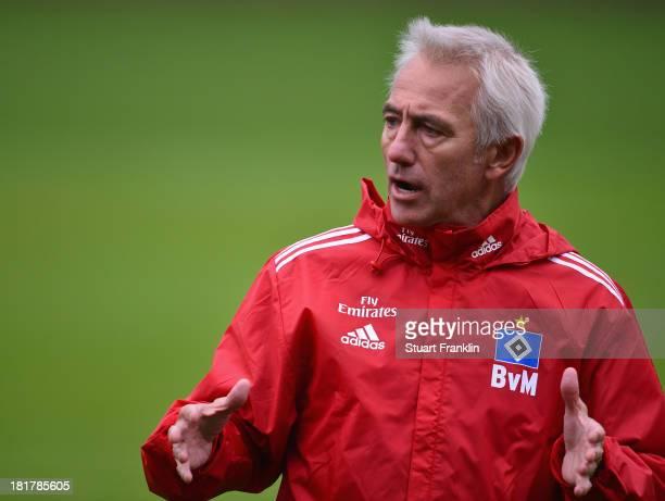 Bert van Marwijk gestures during his first training session as head coach of Hamburg SV on September 25 2013 in Hamburg Germany