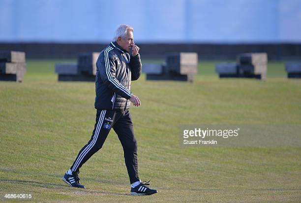 Bert van Marwijk head coach of Hamburger SV ponders during the training session of Hamburger SV on February 11 2014 in Hamburg Germany