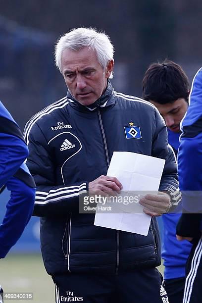 Bert van Marwijk head coach of Hamburger SV ponders during the training session of Hamburger SV on February 14 2014 in Hamburg Germany