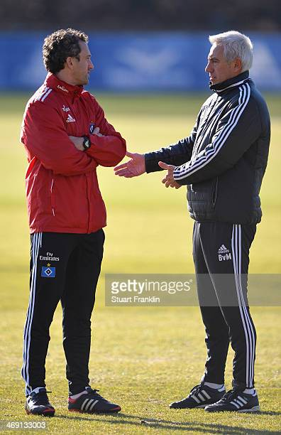 Bert van Marwijk head coach of Hamburger SV talks with his assistant coach Roger Stilz during the training session of Hamburger SV on February 13...