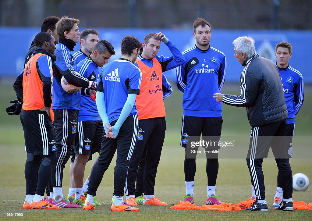 Bert van Marwijk, head coach of Hamburger SV talks with his players during the training session of Hamburger SV on February 11, 2014 in Hamburg, Germany.