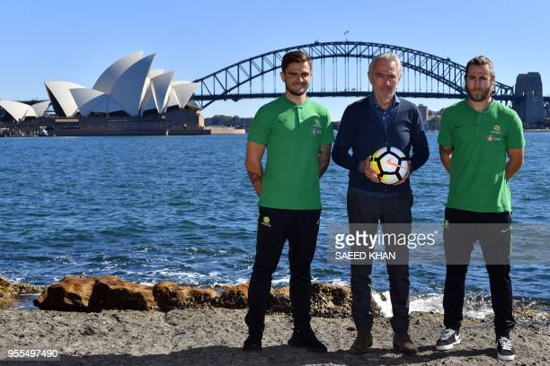 Bert van Marwijk head coach of the Australian national football team poses with players Josh Risdon and Josh Brillante during a photo session in...