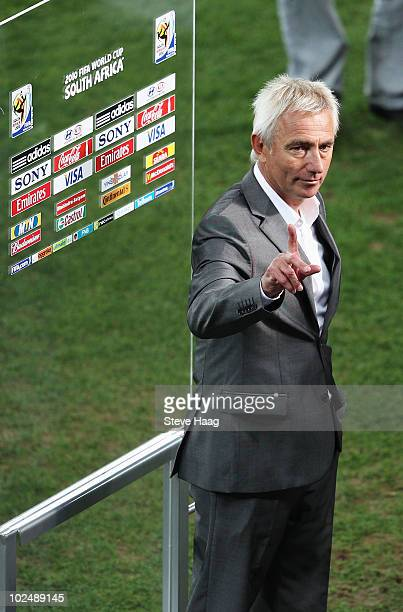 Bert van Marwijk head coach of the Netherlands celebrates victory following the 2010 FIFA World Cup South Africa Round of Sixteen match between...