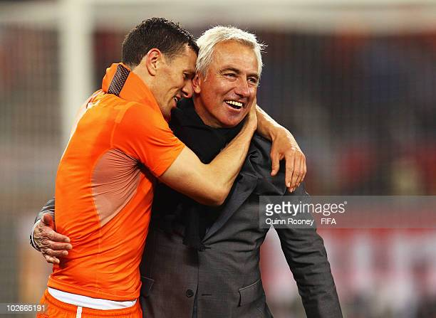 Bert van Marwijk head coach of the Netherlands celebrates with Khalid Boulahrouz after the 2010 FIFA World Cup South Africa Semi Final match between...
