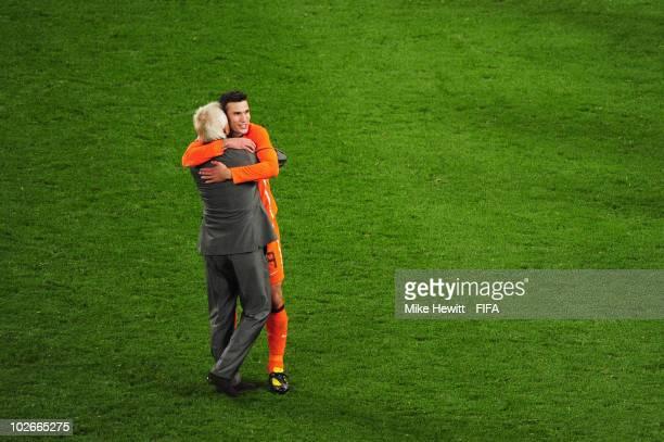 Bert van Marwijk head coach of the Netherlands embraces Robin Van Persie of the Netherlands after the 2010 FIFA World Cup South Africa Semi Final...