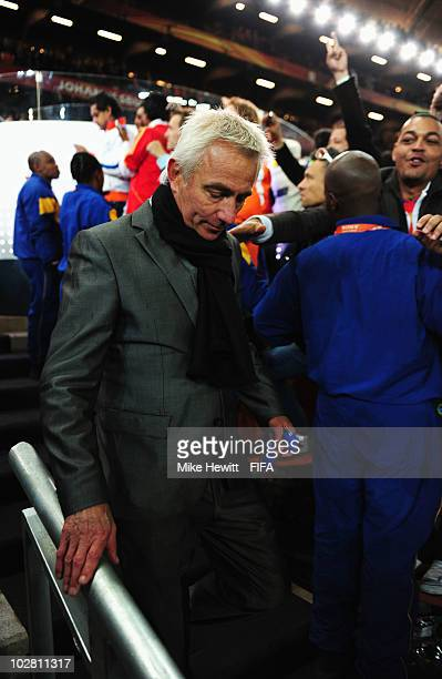 Bert van Marwijk head coach of the Netherlands leaves dejected after the 2010 FIFA World Cup South Africa Final match between Netherlands and Spain...