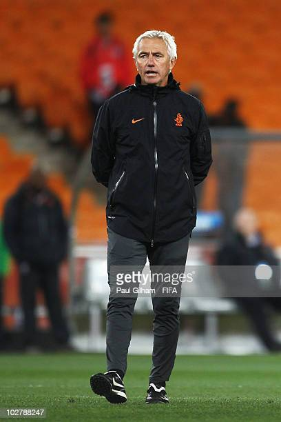 Bert van Marwijk head coach of the Netherlands talks to his players during a Netherlands training session ahead of the 2010 FIFA World Cup Final at...