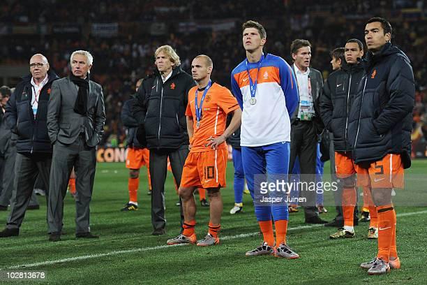 Bert van Marwijk head coach of the Netherlands Wesley Sneijder and captain Giovanni Van Bronckhorst look on dejected as they watch the trophy...