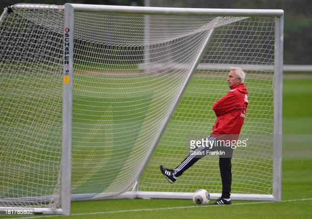 Bert van Marwijk ponders during his first training session as head coach of Hamburg SV on September 25 2013 in Hamburg Germany