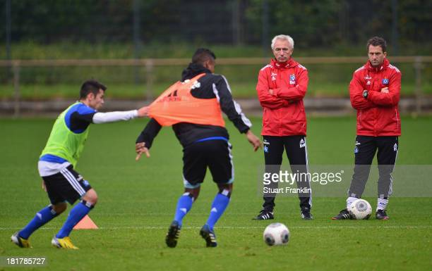 Bert van Marwijk watches during his first training session as head coach of Hamburg SV with his assistant trainer Roger Stilz on September 25 2013 in...