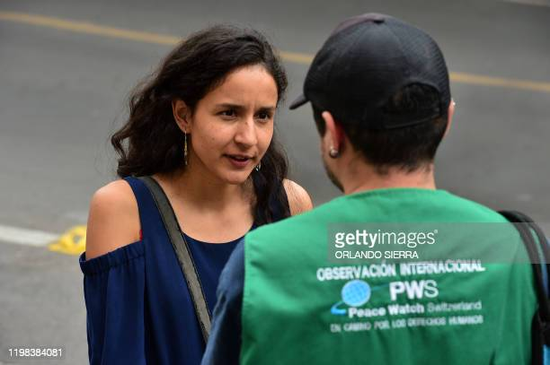 Berta Zuniga daughter of murdered indigenous environmental activist Berta Caceres speaks with a member of Peace Watch Switzerland during a protest in...
