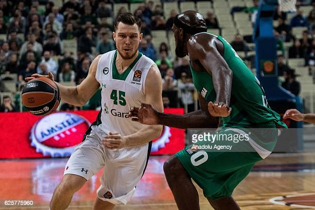 Bertans Dairis of Darussafaka Dogus Istanbul in action against Chris Singleton of Panathinaikos Superfoods Athens during the Turkish Airlines...