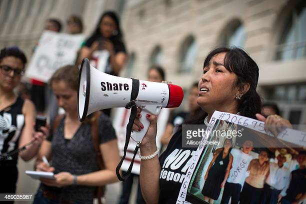 Bertha Avila of El Salvador speaks to protesters in front of the US Customs and Border Protection office housed in the Ronald Reagan building May 9...