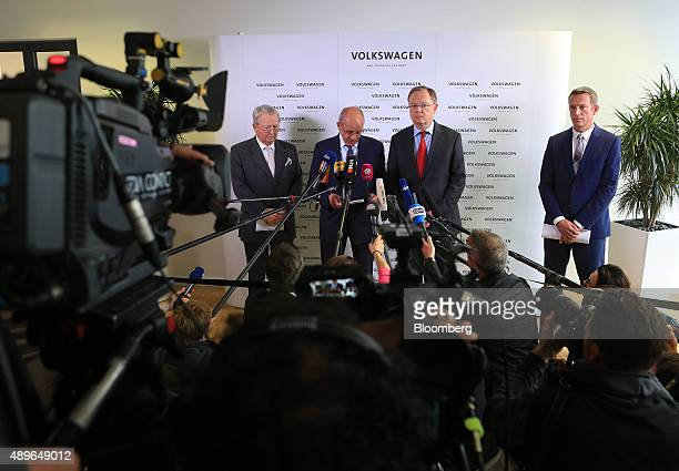 Berthold Huber interim chairman of Volkswagen AG second left speaks while announcing the resignation of VW Chief Executive Officer Martin Winterkorn...