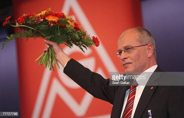 Berthold Huber poses with flowers after his election as new chairman of German labour union IG Metall at the IG Metall annual congress November 6...