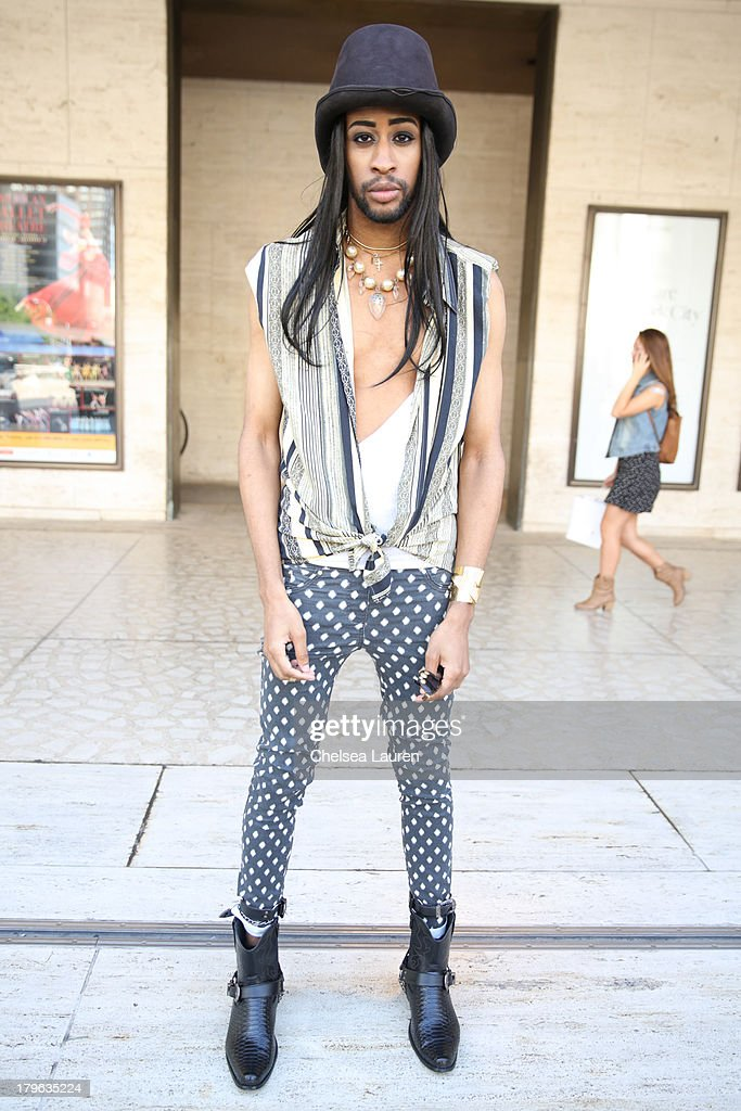 Berthold Jean Charles is seen wearing Tnemroda accessories and H&M pants on the Streets of Manhattan on September 5, 2013 in New York City.