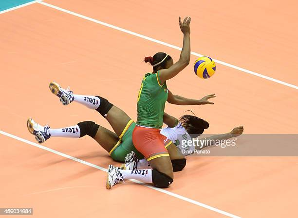 Berthrade Simone Flore Bikatal and Marthe Armelle Bilee Etoga of Cameroon makes a save during the FIVB Women's World Championship pool B match...