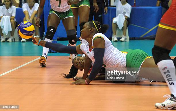Berthrade Simone Flore Bikatal of Camerron makes a save during the FIVB Women's World Championship pool B match between Cameroon and Brazil on...