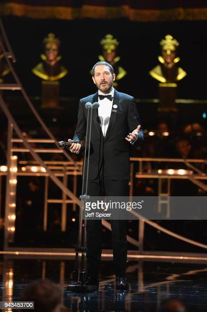Bertie Carvel receives the award for Best Actor In A Supporting Role for 'Ink' on stage during The Olivier Awards with Mastercard at Royal Albert...