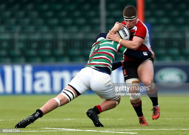 Bertie Stretch of Gloucester Rugby U18 is tackled by George Martin of Leicester Tigers U18 during the Premiership Rugby U18s Academy Final between...