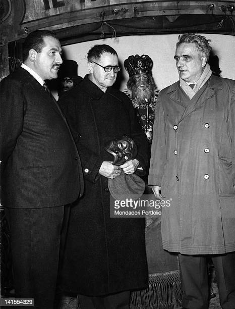 Bertolt Brecht German dramatist poet and theatre director with the Italian theatre producer Paolo Grassi and the Swiss art director Theo Otto