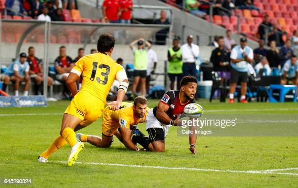 Berton Klaasen of the Southern Kings pops the ball up for Lionel Cronje of the Southern Kings during the Super Rugby match between Southern Kings and...